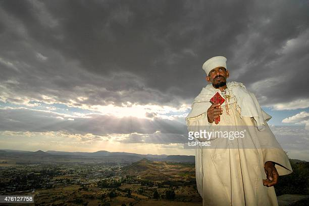 portrait of ethiopian priest holding cross. - axum stock photos and pictures
