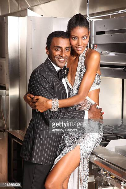 Portrait of Ethiopianborn Swedish chef Marcus Samuelsson and his wife model Maya Haile as they pose together in a restaurant kitchen 2010