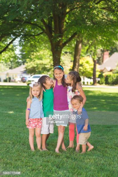 Portrait of ethnic children posing together at the neighborhood park