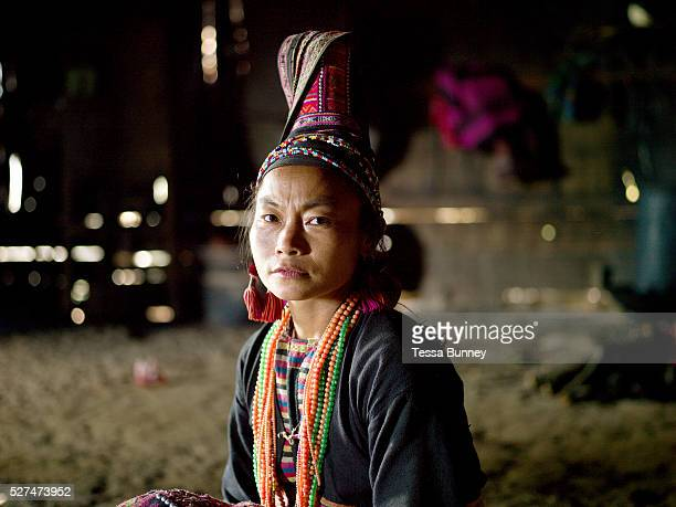 Portrait of Eupae a married Ko Pala ethnic minority woman at home Ban Honglerk Phongsaly Province Lao PDR The conservative clothing of the older Pala...