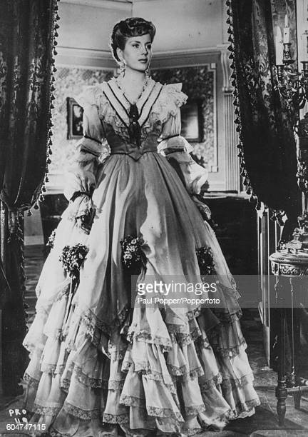 Portrait of Eva Peron wife of President of Argentina Juan Peron wearing a long ruffled dress July 8th 1947