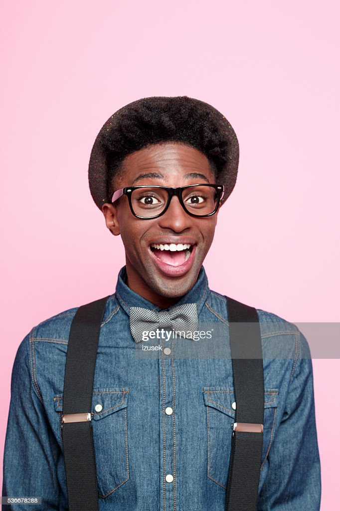 bb7dfbea Portrait Of Excited Afro American Young Man Stock Photo - Getty Images