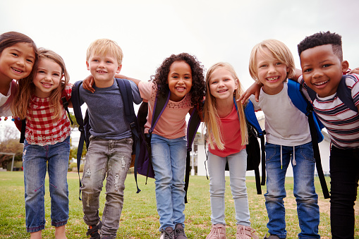 Portrait Of Excited Elementary School Pupils On Playing Field At Break Time 1160932512