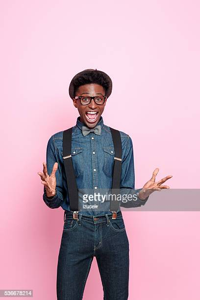 Portrait of excited, fashionable afro american guy
