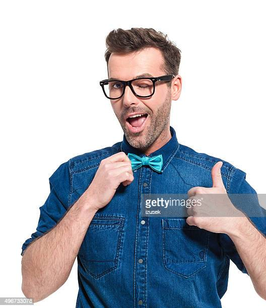 Portrait of excited man wearing jeans shirt and bow tie