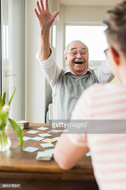 Portrait of excited senior man at home