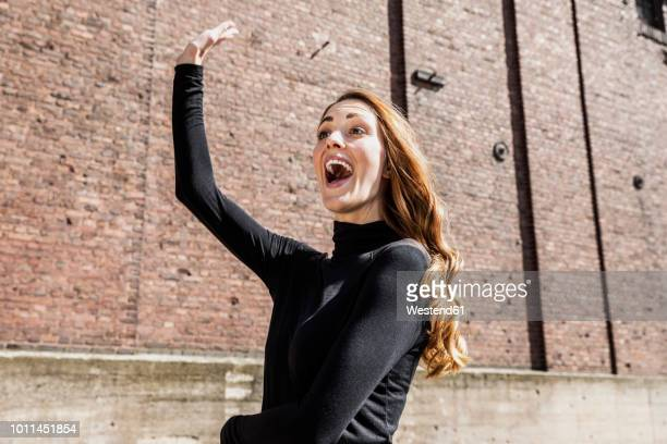 Portrait of excited woman calling someone