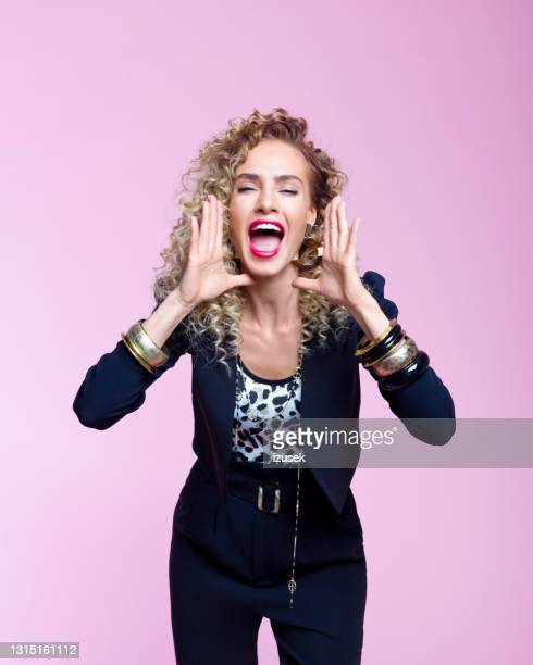 portrait of excited woman in 80's style look - 20th century stock pictures, royalty-free photos & images