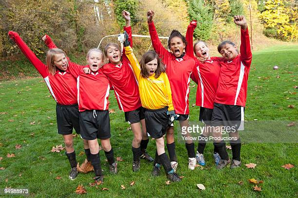 portrait of excited young soccer players - football team stock pictures, royalty-free photos & images