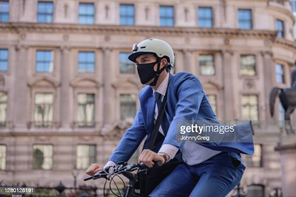 portrait of executive commuting to work in time of covid-19 - riding stock pictures, royalty-free photos & images