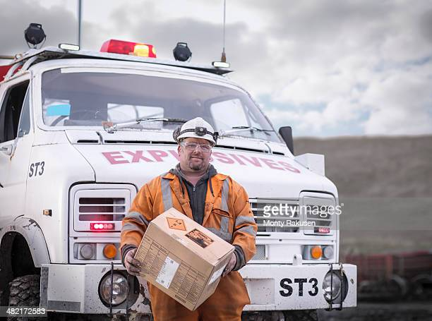 portrait of explosives expert in surface coal mine - explosives stock photos and pictures