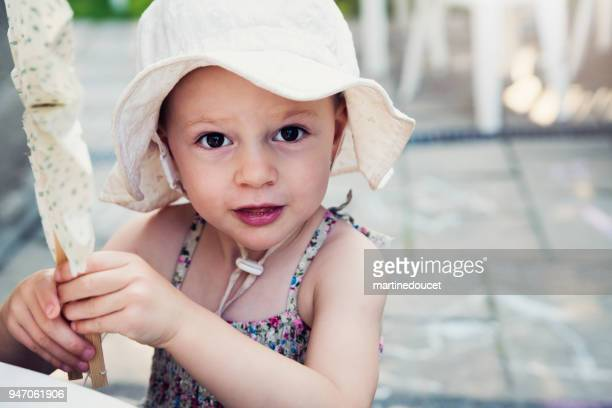 """portrait of expressive little girl at family reunion. - """"martine doucet"""" or martinedoucet stock pictures, royalty-free photos & images"""