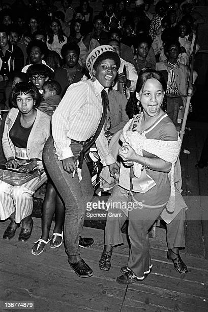 Portrait of exuberant usher at concert at Harvard Stadium, Boston, Massachusetts, 1970s.