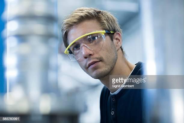 Portrait of factory engineer wearing protective eyeglasses