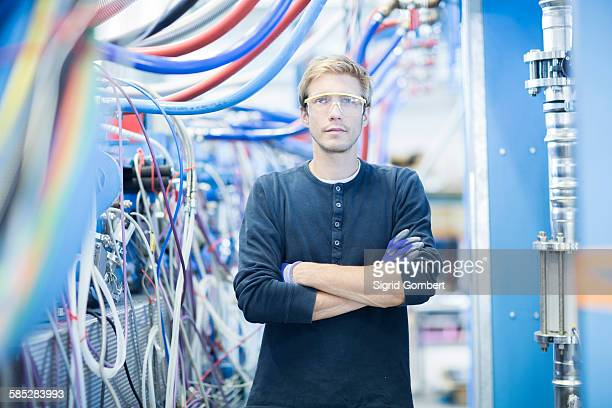 Portrait of factory technician in network room