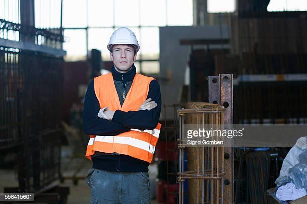 portrait of factory worker in concrete reinforcement factory - sigrid gombert stock-fotos und bilder