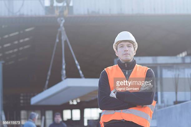 portrait of factory worker outside concrete reinforcement factory - sigrid gombert stock pictures, royalty-free photos & images