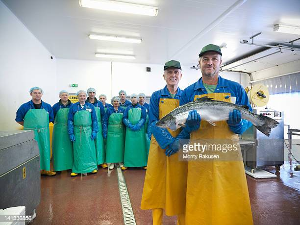 Portrait of factory workforce at hand-reared Scottish salmon farm