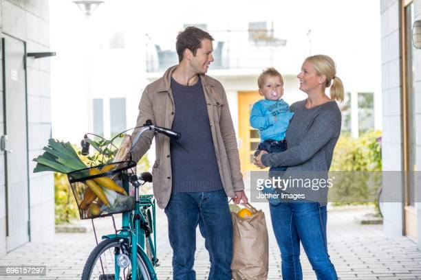 Portrait of family after shopping in grocery