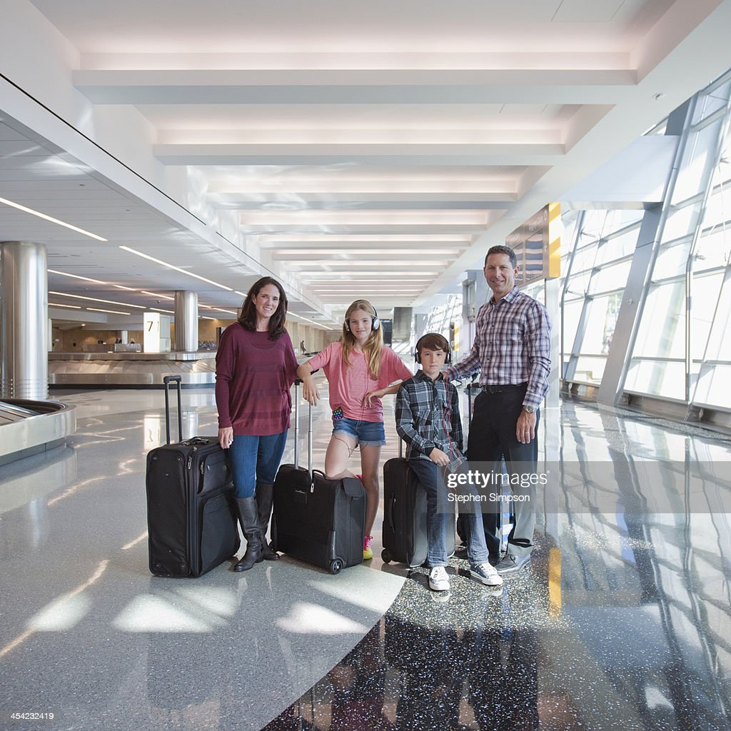 Portrait of family at airport between flights : Stock Photo