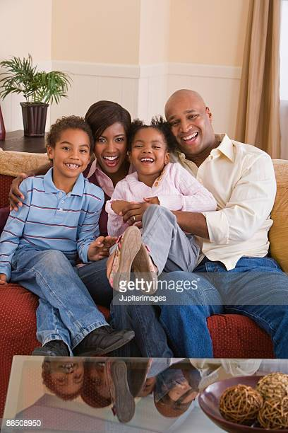portrait of family at home - family at home stock photos and pictures