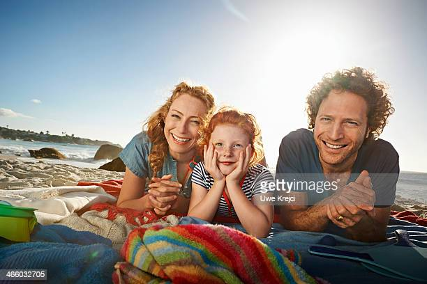 portrait of family at the beach - innocence stock pictures, royalty-free photos & images