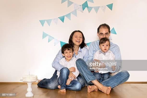 Portrait of family celebrating son's 1st birthday