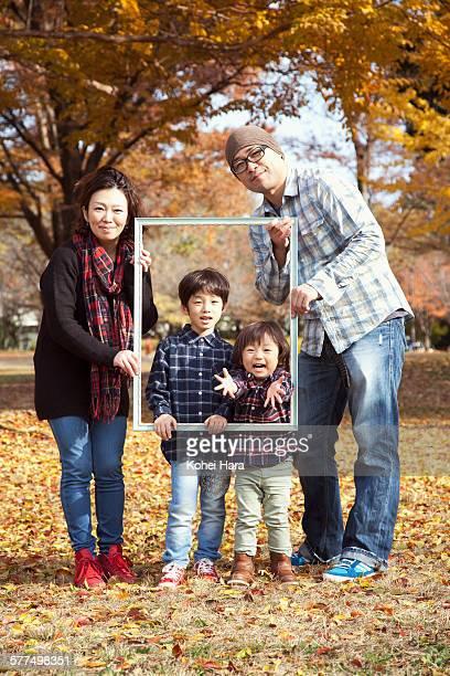 portrait of family in autumn