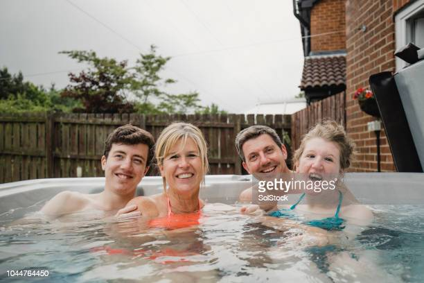 portrait of family in daughters hydrotherapy pool - blood flow stock pictures, royalty-free photos & images