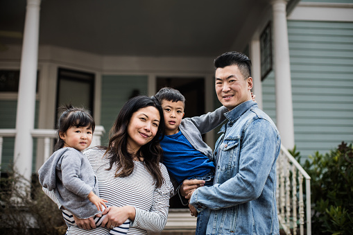 Portrait of family in front of home - gettyimageskorea