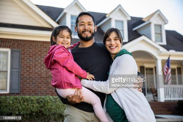portrait of family in front of suburban home - diversity stock pictures, royalty-free photos & images