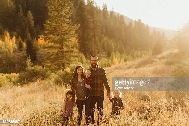 Portrait of family in rural setting, Mineral King, Sequoia National Park, California, USA