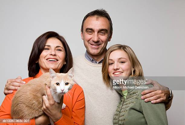 portrait of family including teenage girl (14-15) and cat - one animal stock pictures, royalty-free photos & images