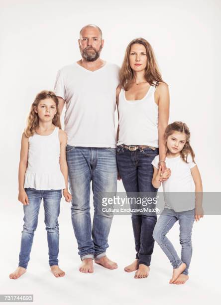 Portrait of family of four, white background
