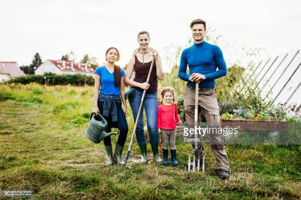 portrait of family of urban farmers - simple living stock pictures, royalty-free photos & images