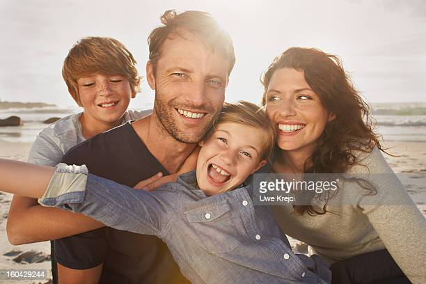 portrait of family outdoors, close up - family with two children stock photos and pictures