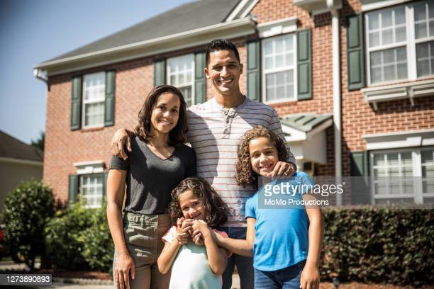 portrait of family outside of their home - authenticity stock pictures, royalty-free photos & images