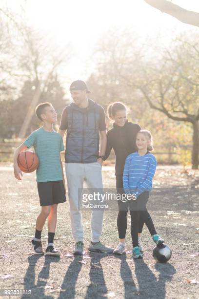 Portrait of family posing outside after a basketball game