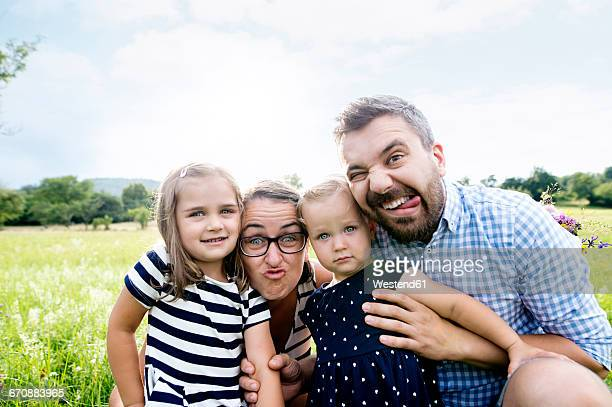 portrait of family pulling funny faces - self portrait stock pictures, royalty-free photos & images