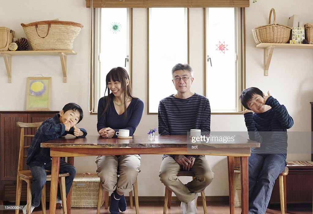 Portrait of family sitting at dining table : ストックフォト