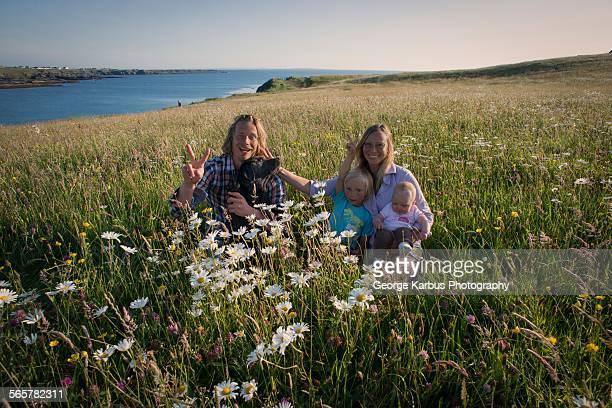 Portrait of family sitting on hillside, White strand, County Clare, Ireland