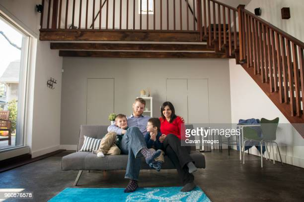 Portrait of family sitting on sofa at home