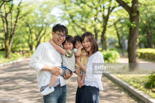 portrait of family under trees - japanese ethnicity stock pictures, royalty-free photos & images