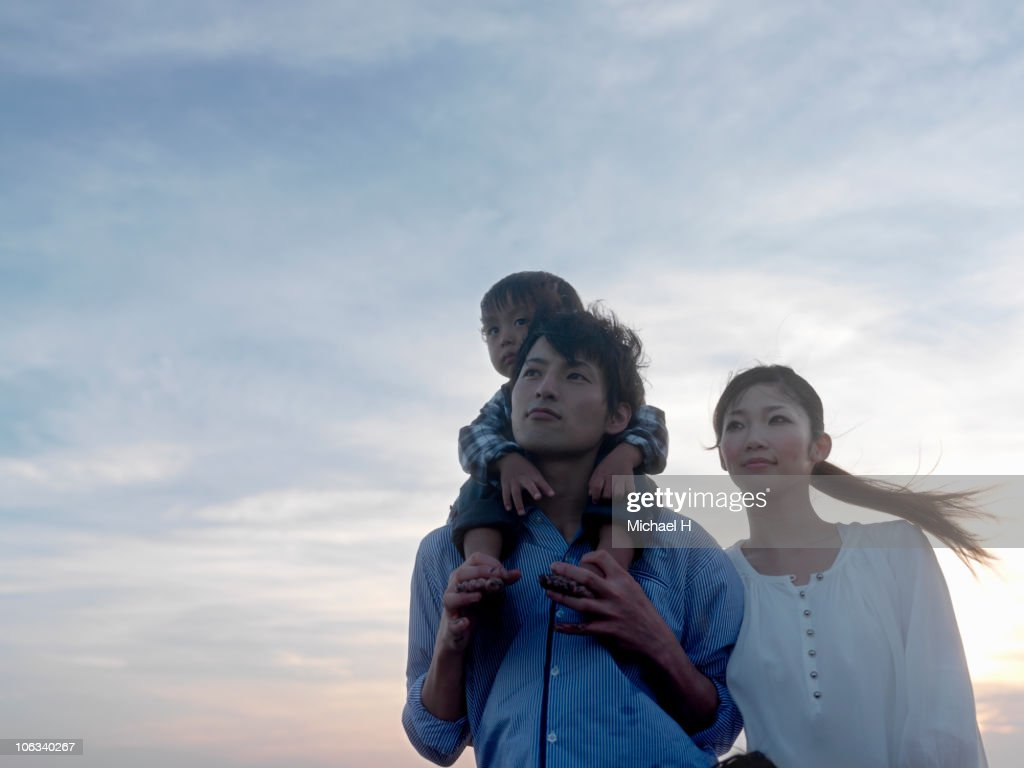 Portrait of family who stands in beach in evening : Stock-Foto