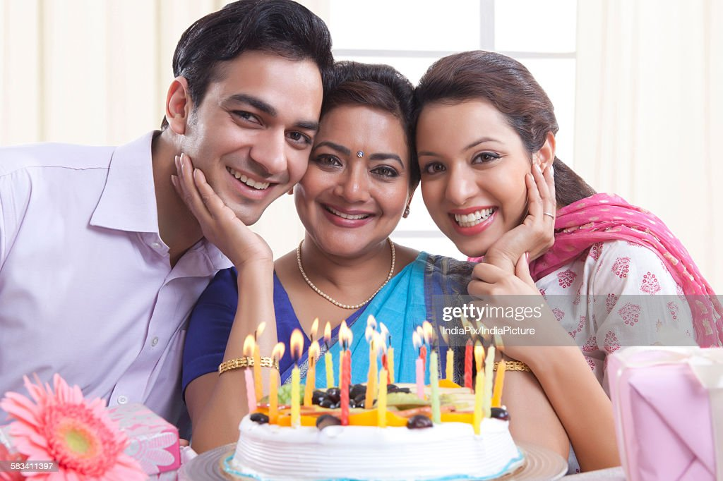 Portrait of family with a birthday cake : Stock Photo