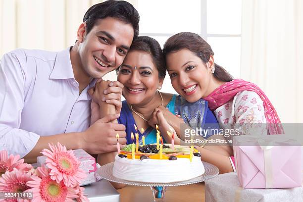 Portrait of family with a birthday cake