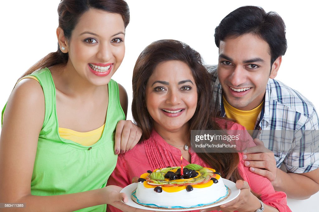 Portrait of family with a cake : Stock Photo