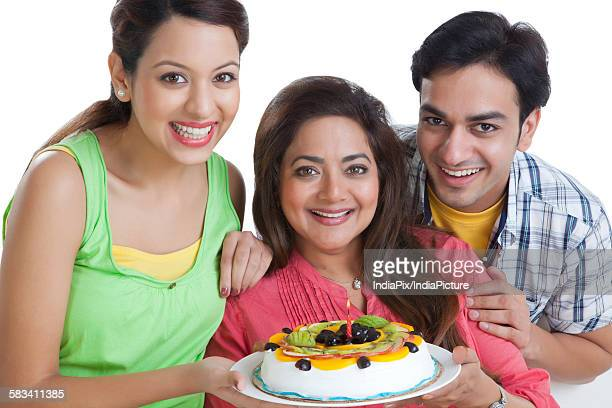 Portrait of family with a cake