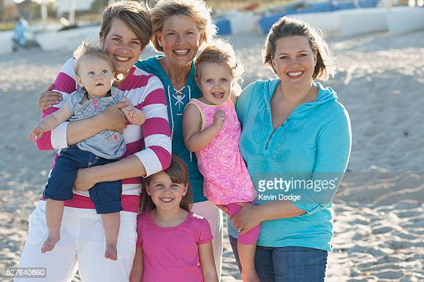portrait of family with children (12-23 months, 2-3, 4-5 years) on beach - 55 59 years stock pictures, royalty-free photos & images