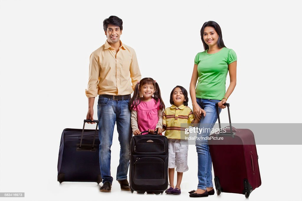 Portrait of family with suitcases : Stock Photo